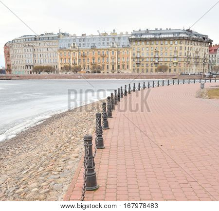 View of Frozen Neva River and Petrograd side in center of St.Petersburg at cloudy winter day Russia.