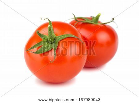 Two ripe red tomatoes on white background