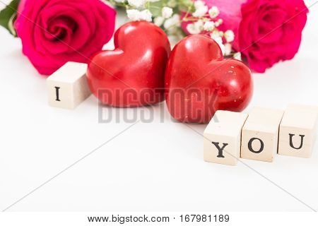 Two Red Hearts And Roses, And Wooden Cubes With Words I And You, On White Background. I Love You Con