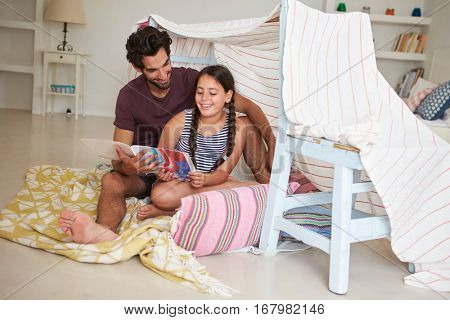 Father And Daughter Playing Indoors In Home Made Den