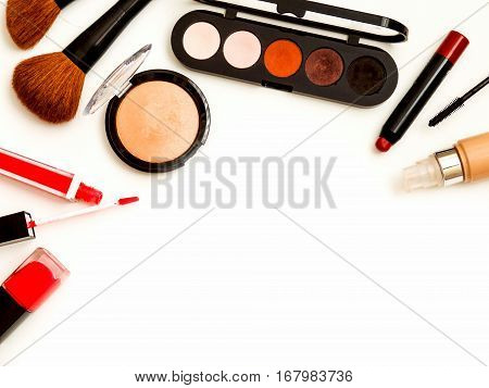 cosmetics top view isolated on white. Workplace, cosmetics, lipstick, nail Polish, mascara and eyeshadow