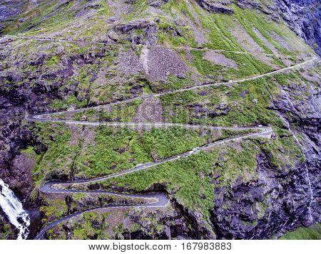 Troll's Path Trollstigen or Trollstigveien winding mountain road in Norway aerial photography.