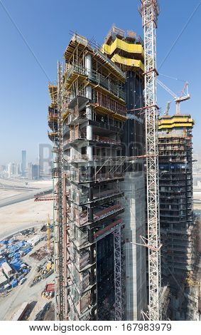 United Arab Emirates, Dubai, 05/21/2015, Damac Towers Dubai by Paramount, construction and building ariel views with cityscape background