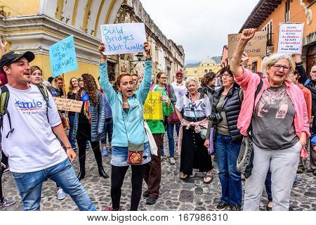 Antigua, Guatemala - January 21 2017: Locals & foreigners wave signs & chant in peaceful Women's March as part of global protest protecting women's rights & other causes