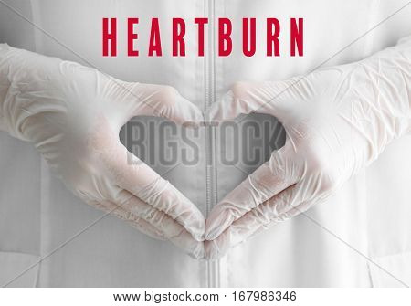 Cardiology and health care concept. Doctor making heart shape of hands