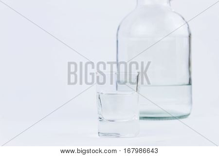Object Photography Of A Shot Glass And A Bottle Of Vodka