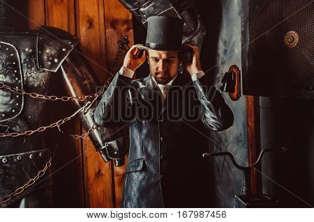 Side Portrait Of Victorian Gentleman Adjusting His Top Hat.