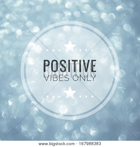 Positive vibes only inspirational quote on blue bokeh background