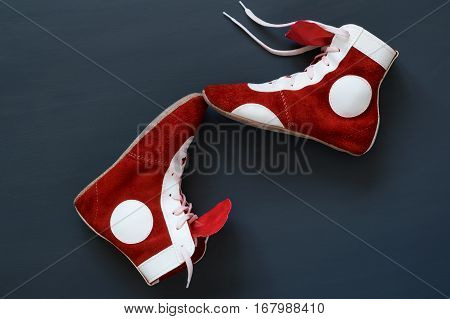 two sports shoe to combat lie on the floor