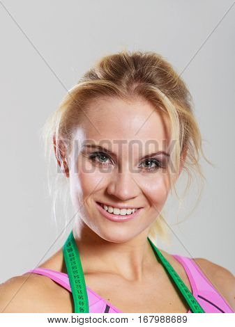 Sporty Smiling Girl With Measuring Tape