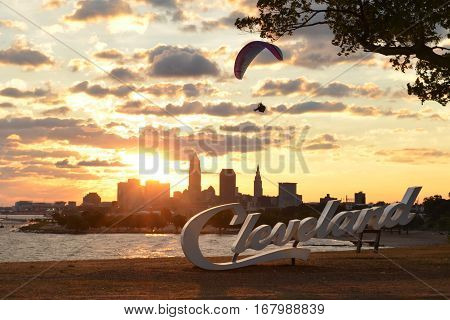 Morning view of Cleveland skyline, Lake Erie, and paraglider from Edgewater park