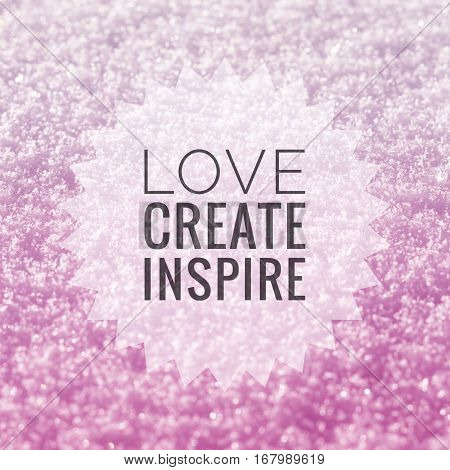 Love create inspire inspirational quote on shiny pink glitter background
