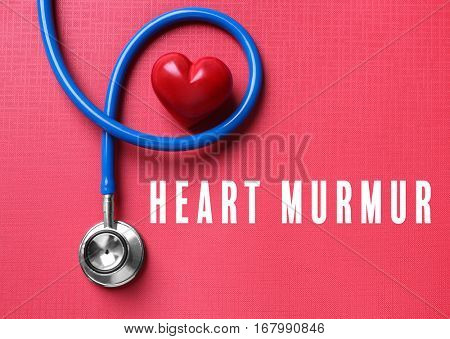 Cardiology and health care concept. Heart and stethoscope on color background