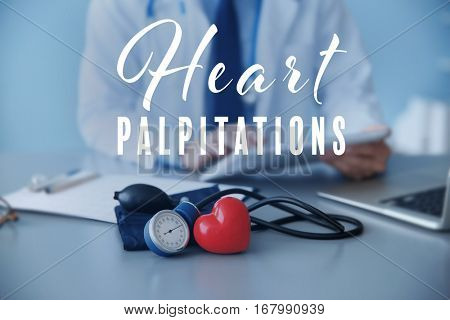 Cardiology and health care concept. Heart with medical equipment and doctor on background