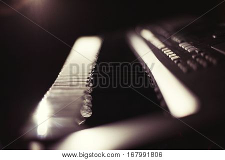 Synthesizer keyboard in the dark retro effect