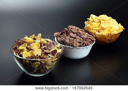 the three plates with different corn flakes