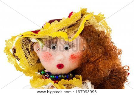 Handmade doll isolated on white background
