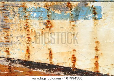 Background: colored weathered planks of a shipwreck