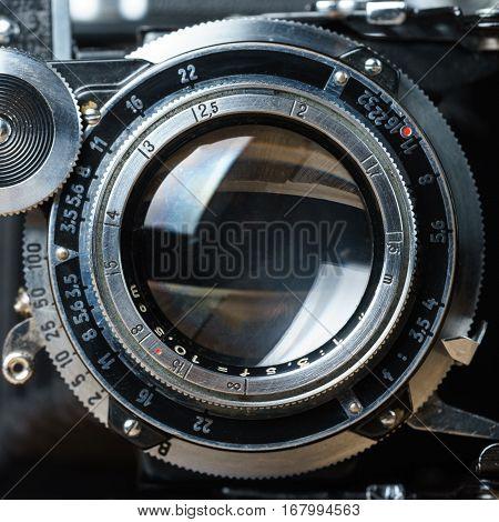 old folding camera lens front view closeup