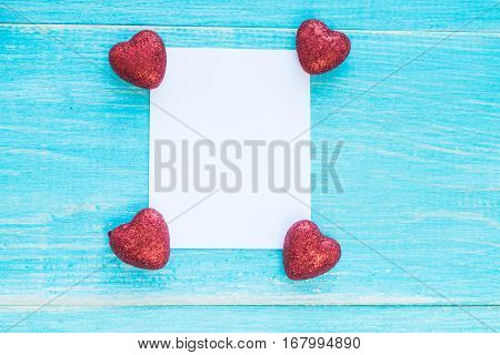 Blank paper and candies. Box of chocolates on wood. Send your best wishes