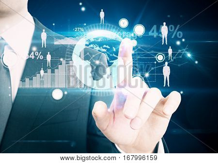 Businessman pointing at abstract digital interface with business charts and HR icons on space background