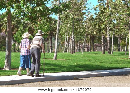 Old Couple Walking In The Park Revised