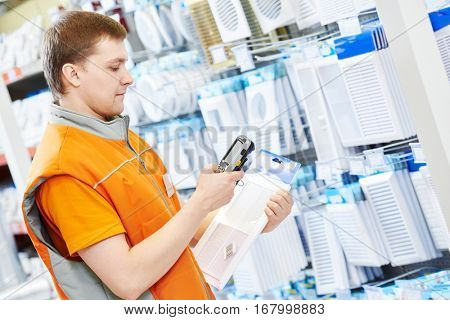 hardware store salesman worker with barcode scanner
