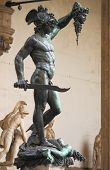 Statue of Perseus holding the head of Medusa in Florence, Italy poster