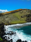 Green sand is formed naturally from volcanic rock on Hawaii's big island creating a green beach. poster