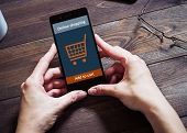 A woman is shopping at the online store. Shopping cart icon. ecommerce poster