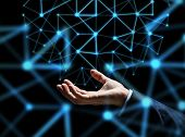 business, people, network, cyberspace and future technology concept - close up of businessman hand with hologram over dark background poster