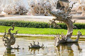 Thai Myth Dragon Sculpture Splashing Water in Wat Rong Khun Thailand