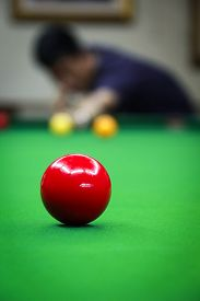 Red Ball Backgrouded with Man Playing Snooker