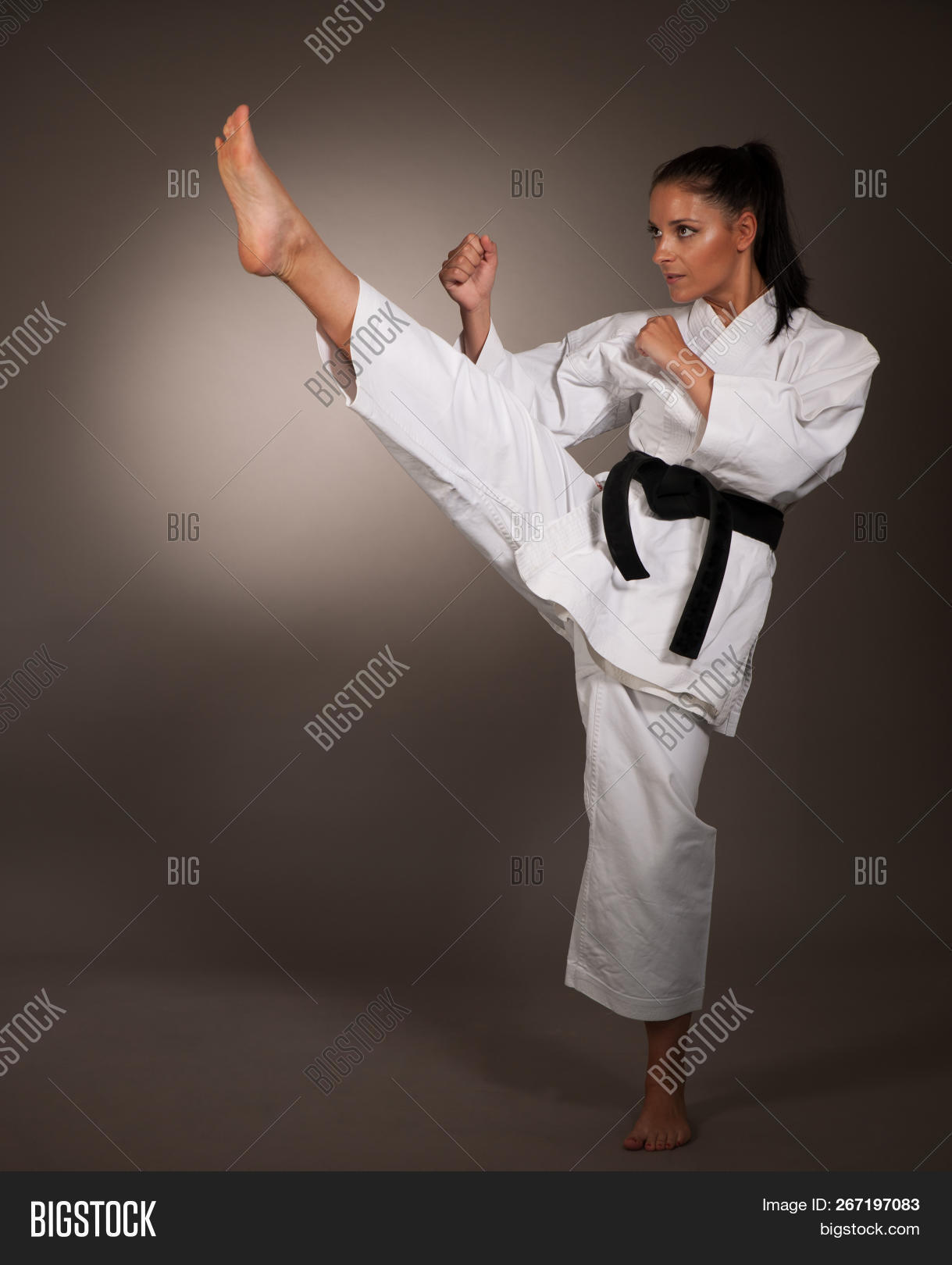 Woman In White Kimono Kicks High In The Air - A Karate Martial Art Girl