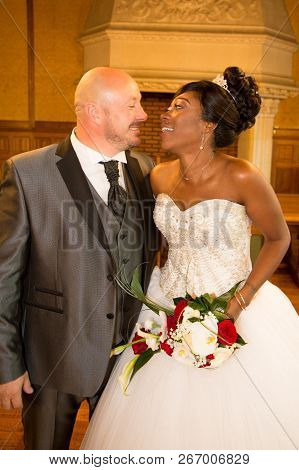 Modern Attractive Multi Racial Couple African Bride And American Caucasian Groom During Wedding Cele
