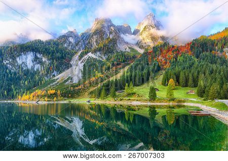 Beautiful View Of Idyllic Colorful Autumn Scenery With Dachstein Mountain Summit By Gosausee Mountai