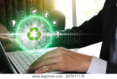 Hand Use Laptop Computer With Environment Icons Over The Network Connection On Nature Background, Te