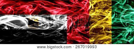 Egypt, Egyptian Vs Guinea, Guinean Smoke Flags Placed Side By Side. Thick Abstract Colored Silky Smo