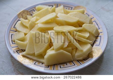 Chopped Potatoes. In The Chopped Potato Plate . Sliced, Peeled Raw Potatoes On A Board . Chopped Pot