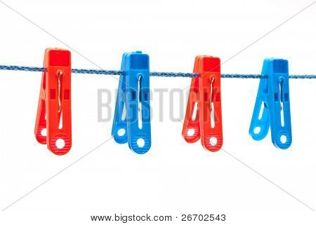 Clothespins hang on a cord