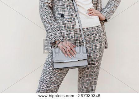 Stylish Beautiful Women's Handbag. Young Girl In Fashion Checkered Suit With Handbag. Close-up
