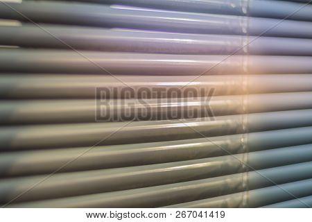 Closed Shutters Macro Shot. Jalousie Background. Sunlight Through Horizontal Blinds
