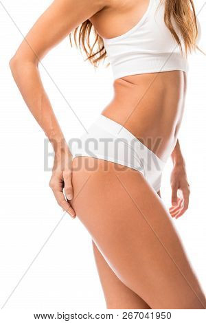 Side View Midsection Of Woman With Hand On Buttock Over White Background