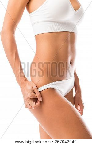 Erotic Woman Pulling Down Her Panty While Standing Against White Background