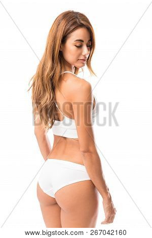 Cute Hispanic Woman Wearing White Lingerie Against White Background