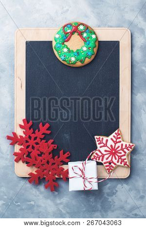 Christmas Chalkboard With Copy Space. Christmas Sales Concept. Blackboard And Christmas Decorations
