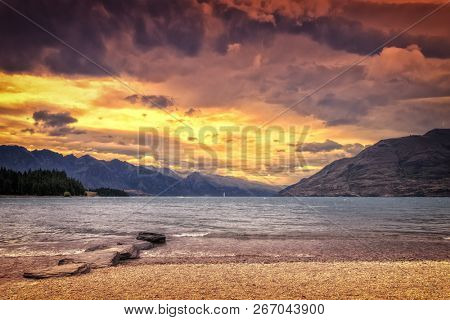 An image of the Lake Te Anau in New Zealand at sunset