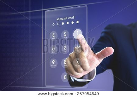 Businessman Entering Security Passcode On A Virtual Login Keypad Screen To Login To An Encrypted Com