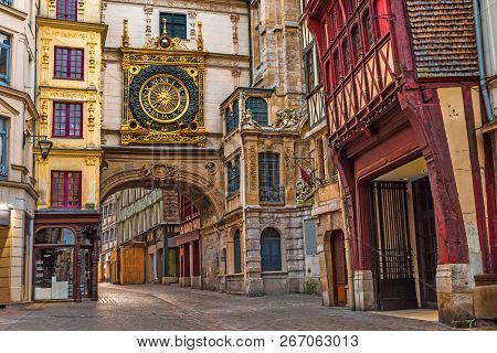Old Cozy Street In Rouen With Famous Great Clocks Or Gros Horloge Of Rouen, Normandy, France With No