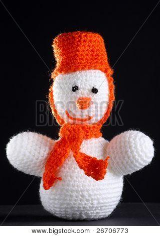 White Snowman At The Dark Background